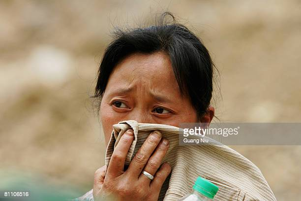 A victim waits to find her lost relatives at a landing point at Zipingba dam from Yingxiu county on May 16 2008 between Wenchuan and Dujiangyan...