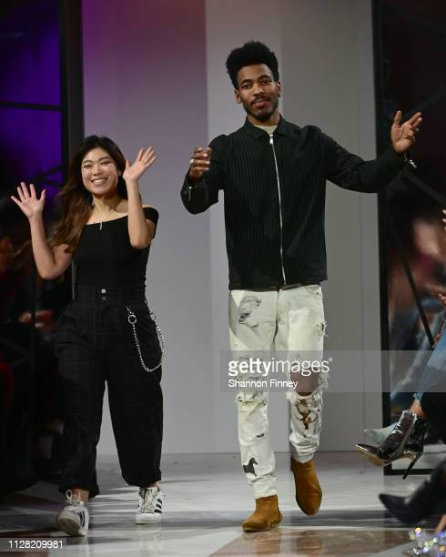 Victim15 designers Hora and Shareef Mosby take their bows onstage at the District of Fashion Fall/Winter 2019 Runway Show on February 07 2019 at the...