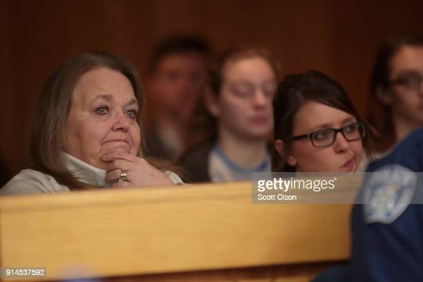 Victims and their family members listen at the sentencing hearing for Larry Nassar in Eaton County Circuit Court on February 5 2018 in Charlotte...