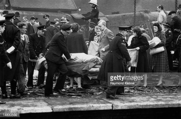 Victims are carried away from Harrow Wealdstone station in Middlesex after a disastrous rail crash October 1952 A local passenger train from Tring...