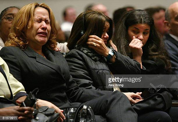Victims' family members of the crash of American Airlines flight 587 Olivia Ortiz and Ana Zabala cry during a meeting to unveil findings of the...
