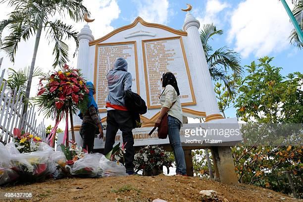 Victim's family members offer flower tributes at the site of the of the 'Maguindanao massacre' also know as the 'Amputuan Massacre' on November 23...