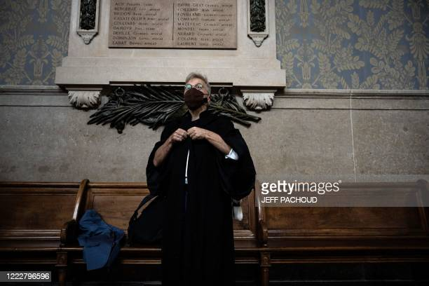 Victims lawyer Christophe Leguevaques arrives at the courthouse of Lyon centraleastern France on June 25 for the ruling in the appeal trial of German...