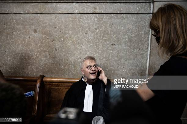 Victims lawyer Christophe Leguevaques reacts as he learns on the phone the ruling in the appeal trial of German pharmaceutical company Merck over the...