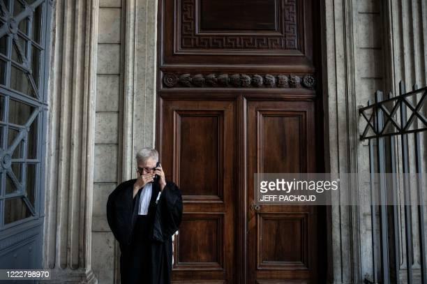 Victims lawyer Christophe Leguevaques speaks on the phone at the courthouse of Lyon centraleastern France on June 25 after the ruling in the appeal...