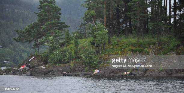 Victims lie on the banks following terror shootings at a summer youth camp on July 22 2011 on Utoya Island Norway Reports suggest that at least 84...