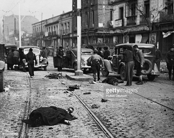 Victims lie on the ground in the aftermath of an air raid on a Spanish town during the Civil War