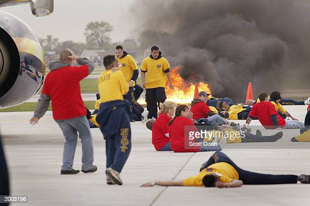 Victims of a simulated plane crash role play at Midway Airport during a large-scale exercise testing the ability the U.S. To respond to a terrorist...