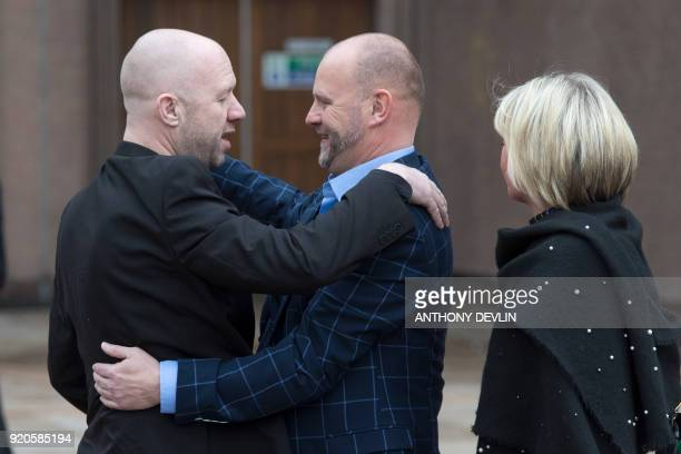 Victims of abuse by former football coach Barry Bennell Jason Dunsford and Chris Unsworth embrace outside Liverpool Crown Court on February 19 2018...