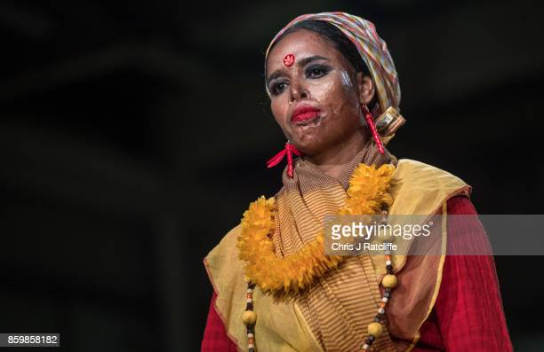 Victims of acid attacks showcase fashion on the catwalk during the ActionAid Fashion Show held at The Old Truman Brewery on October 10 2017 in London...