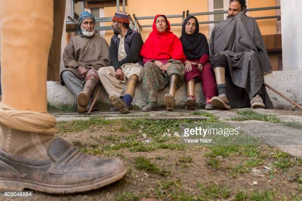 Victims of cross border shelling who have lost their legs between 2000 and 2017 take shelter in a government building during a fresh skirmish along...