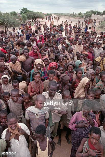 Victims of famine gather for food during Somalia's civil war. In the 1980s warlord factions joined together to overthrow then president Siad Barre,...