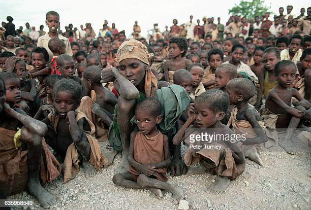 Victims of famine gather for food during Somalia's civil war In the 1980s warlord factions joined together to overthrow then president Siad Barre who...