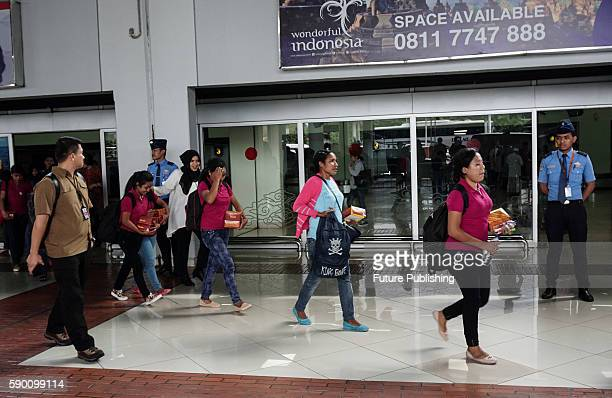 Victims of human trafficking arrive at SoekarnoHatta Airport on August 16 2016 in Tangerang Indonesia 9 Suspects while smuggling 16 people from the...