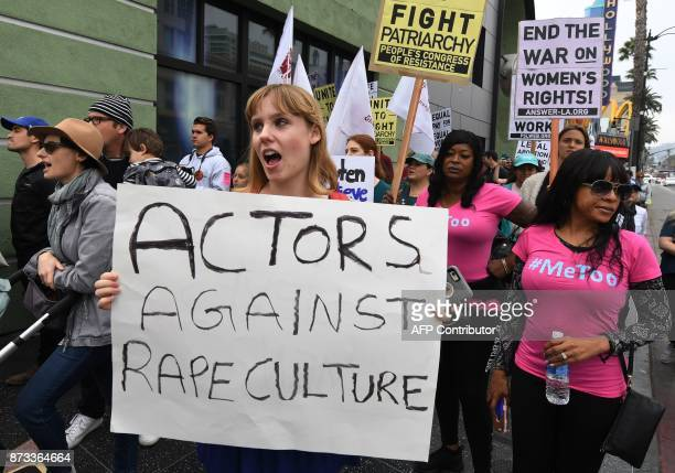 Victims of sexual harassment sexual assault sexual abuse and their supporters protest during a #MeToo march in Hollywood California on November 12...