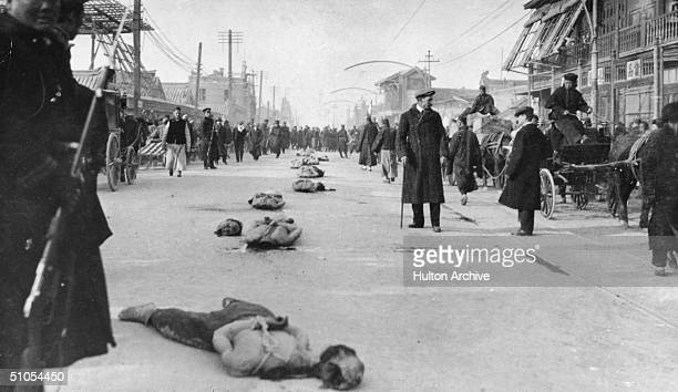 Victims of the Chinese Revolution lie beheaded in the street 1911
