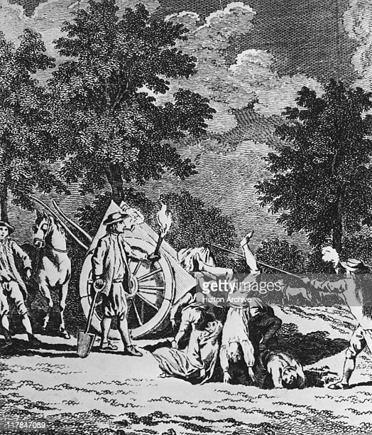 Victims of the Great Plague of London are buried in a mass grave at Holy Well Mount Shoreditch London 1665 The workers are smoking pipes in an...
