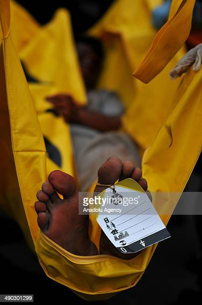 Victims of the president reelection protest are evacuated by health wokers personnel during the riot simulation of presidential election on May 14...