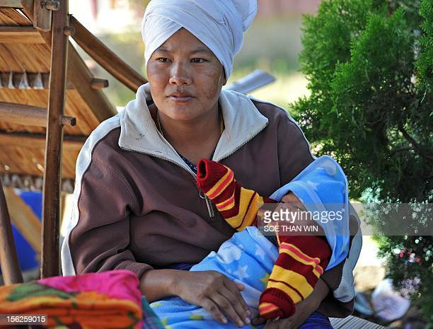 Victims of the recent earthquake sit at a temperory relief camp in Thabeik Kyin township Mandalay a division in central Myanmar on November 12 2012...