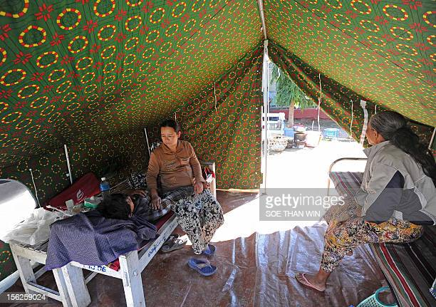 Victims of the recent earthquake sit in a tent at a temperory relief camp in Thabeik Kyin township Mandalay a division in central Myanmar on November...