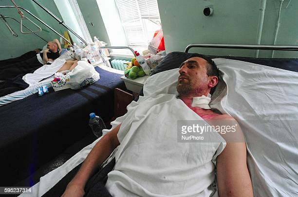 Victims of the Trade Union building fire recover in one of the burn unit wards at Yevreyskaya hospital. More then 30 people were killed after they...