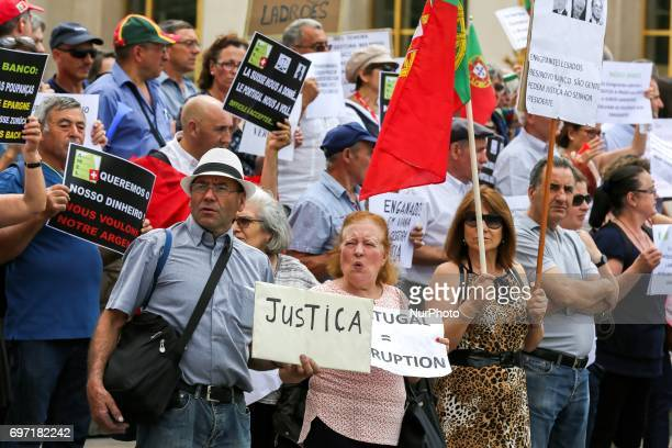 Victims of toxic investments made by former Banco Espirito Santo now Novo Banco hold a poster reading in Portuguese quotJusticequot in front of the...