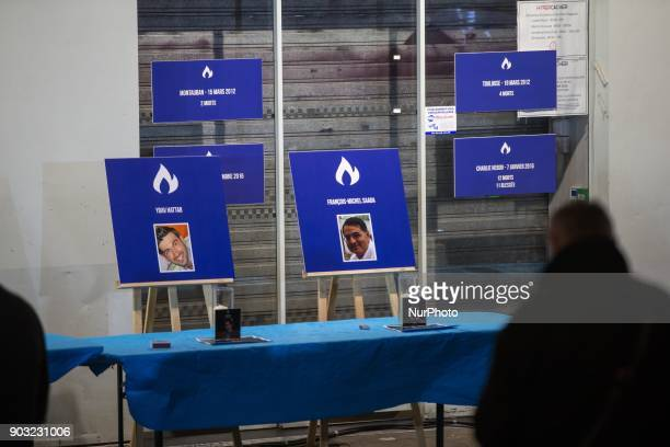 Victims portraits during a gathering organized by the Representative Council of France's Jewish Associations outside the Hyper Casher supermarket in...