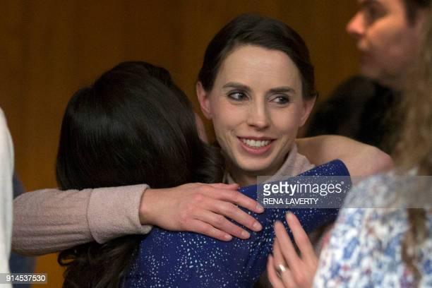 TOPSHOT Victims Rachael Denhollander hugs Larissa Boyce at the conclusion of the sentencing of Former Michigan State University and USA Gymnastics...