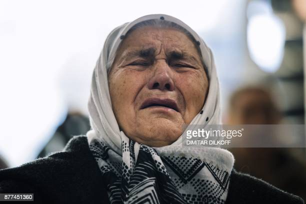 Victim's relative reacts as she watches a live TV broadcast from the International Criminal Tribunal for the former Yugoslavia in a room at the...