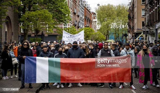 Victims' relatives and local residents march in silence through De Pijp quarter in Amsterdam, on May 27, 2021. - A 29-year-old man stabbed five...