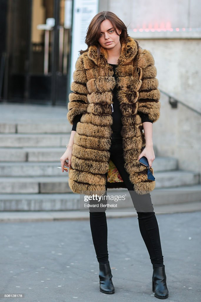 Victoia Maykova wearing a fur coat of her own design after the Rick Owens show during Paris Fashion Week Menswear Fall Winter 2016/2017 on January 21, 2016 in Paris, France.