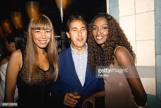 Victoire de Castellane Gilles Dufour and Katoucha Niane attend a fashion week Party at Les Bains Douches in the 1990s in Paris France