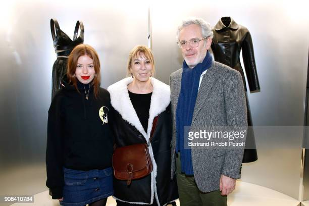 Victoire de Castellane standing between her husband Thomas Lenthal and their daughter Zoe Lenthal attend the Azzedine Alaia Je Suis Couturier...