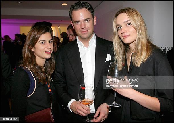 Victoire of Pourtales Arne Ehmann and Hella Pohl holding Sylvie Fleury's art piece 'La Levre Au Verre' at Exclusive Presentation Of Dom Perignon Rose...