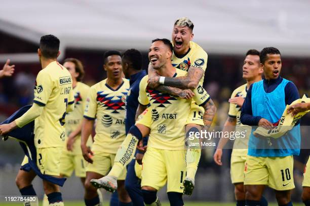 Victor Aguilera and Nicolas Castillo of America celebrate after winning the Semifinals second leg match between America and Morelia as part of the...