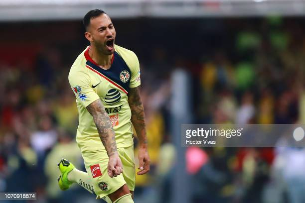 Victor Aguilera of America celebrates after scoring the 6th goal of his team during the semifinal second leg match between America and Pumas UNAM as...