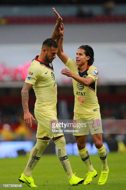 Victor Aguilera of America celebrates after scoring the first goal of his team with teammate Diego Lainez during the 13th round match between America...