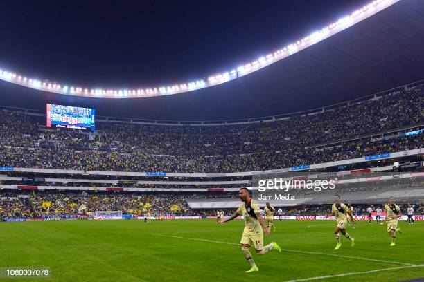 Victor Aguilera of America celebrates after scoring the sixth goal during the semifinal second leg match between America and Pumas UNAM as part of...