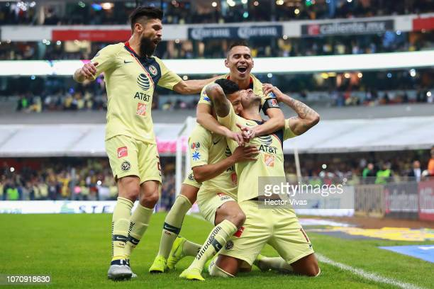Victor Aguilera of America celebrates with teammates after scoring the 6th goal of his team during the semifinal second leg match between America and...