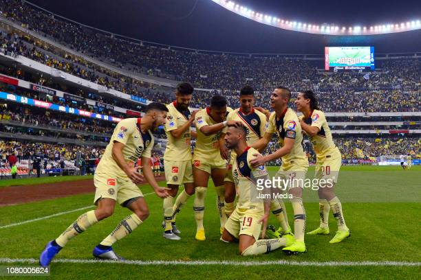 Victor Aguilera of America celebrates with teammates after scoring the sixth goal during the semifinal second leg match between America and Pumas...