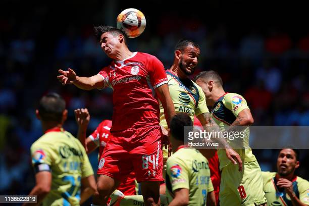 Victor Aguilera of America struggles for the ball with Adrian Mora of Toluca during the 15th round match between Toluca and America as part of the...