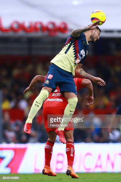 Victor Aguilera of America struggles for the ball with Pedro Canelo of Toluca during the 12th round match between America and Toluca as part of the...