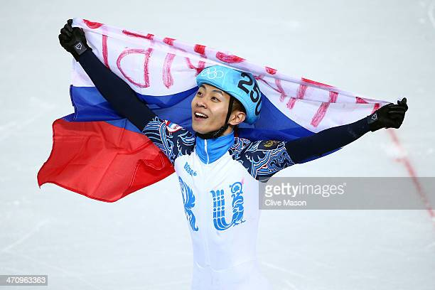 Victor An of Russia celebrate winning the gold medal in the Short Track Men's 500m Final A on day fourteen of the 2014 Sochi Winter Olympics at...