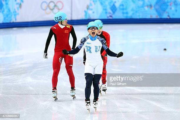 Victor An of Russia celebrates winning the gold medal in the Short Track Men's 500m Final A on day fourteen of the 2014 Sochi Winter Olympics at...