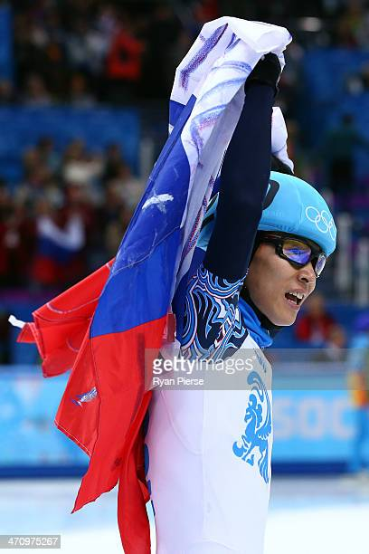 Victor An of Russia celebrates winning the gold medal in the Short Track Men's 5000m Relay Final A on day fourteen of the 2014 Sochi Winter Olympics...