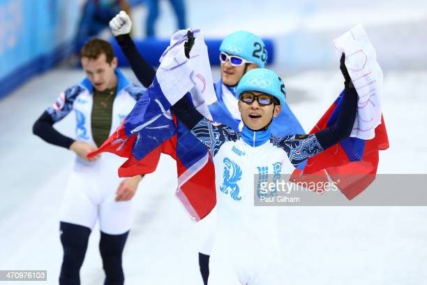 Victor An of Russia celebrates winning the gold medal in the Short Track Men's 5000m Relay on day fourteen of the 2014 Sochi Winter Olympics at...