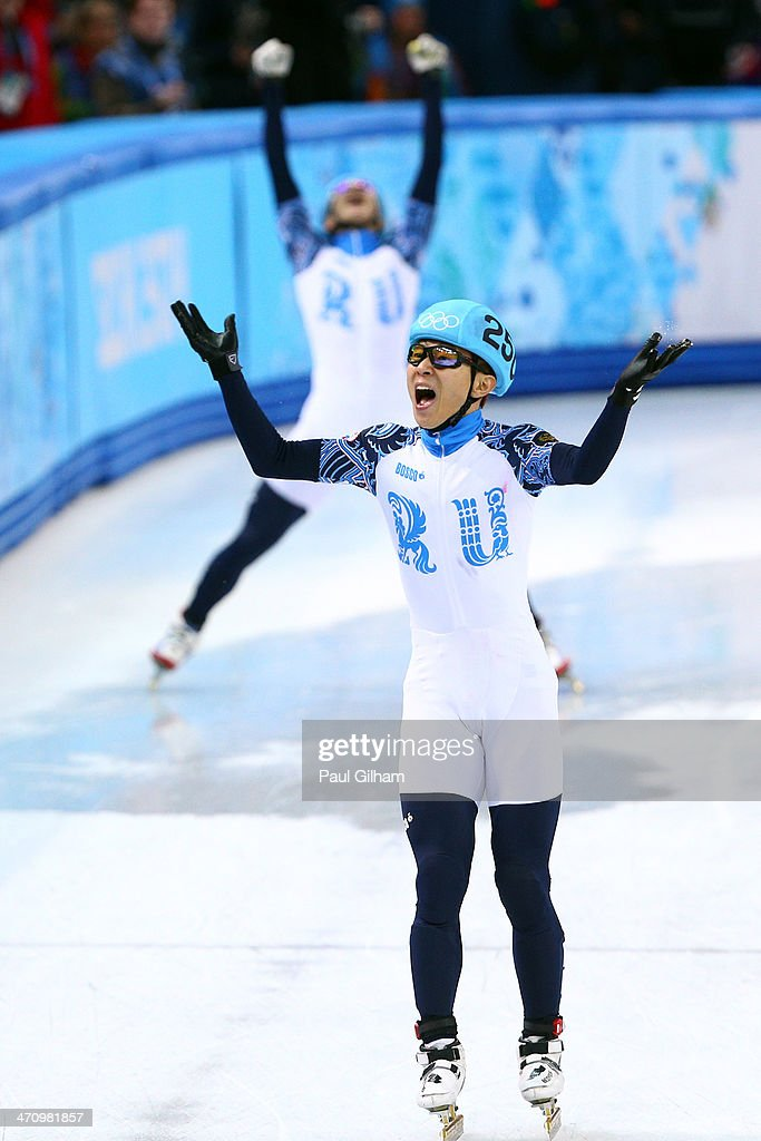 Victor An of Russia celebrates winning the gold medal in the Short Track Men's 5000m Relay on day fourteen of the 2014 Sochi Winter Olympics at Iceberg Skating Palace on February 21, 2014 in Sochi, Russia.