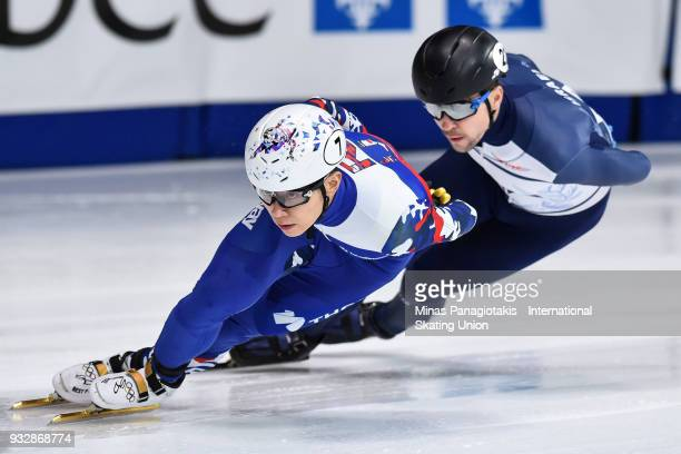 Victor An of Russia competes in the men's 1500 meter heats during the World Short Track Speed Skating Championships at Maurice Richard Arena on March...