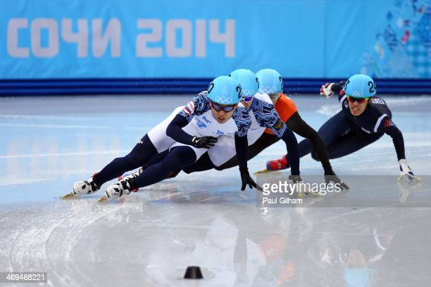 Victor An of Russia leads the pack during the Men's 1000 m Final Short Track Speed Skating on day 8 of the Sochi 2014 Winter Olympics at the Iceberg...