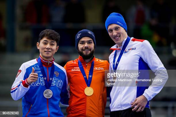 Victor An of Russia Sjinkie Knegt of Netherlands and Sebastien Lepape of France pose in the Men's 500m medal ceremony during day two of the European...